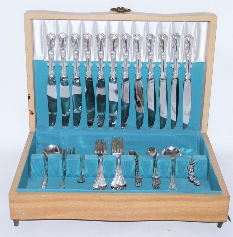 Serving for 12 nickle silver. 60 pcs set with original maple wood silver storage box. Lovely Aqua green/mint interior.