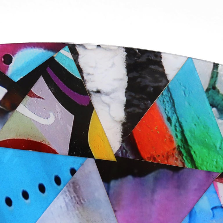 Nicola Katsikis' original artworks are creative combinations of her own photographs of street art and graffiti that she discovers in the urban environment. Each photograph adds color and depth to her mixed media artworks, showing the material the