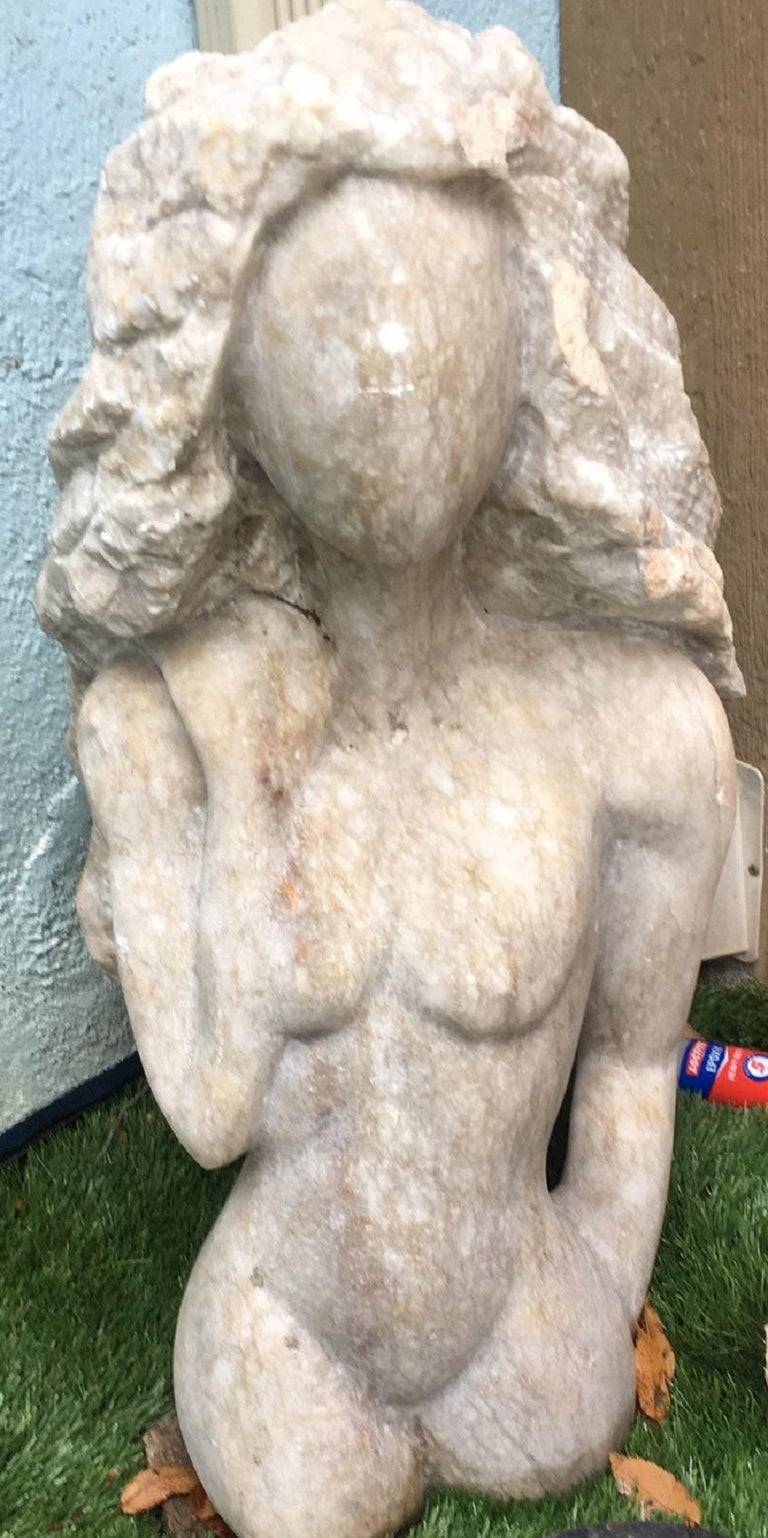Femme , white alabaster direct carving represents the symbol of Feminity and the Godess inside each woman. Nicole was born in Lyon,France from an Italian mother and french father she now has her art studio on the italian riviera. Her work exhibits a