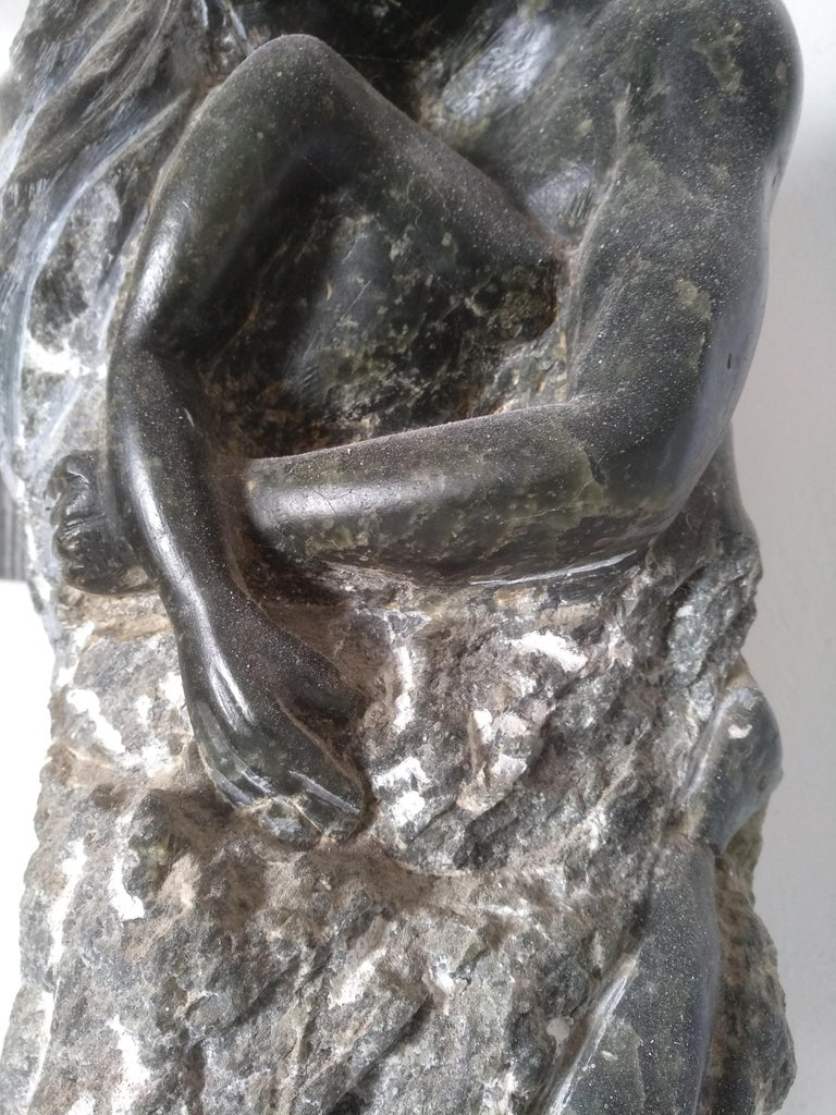 Fusion is a very romantic sculpture for 2 lovers feeling the fusion. The snake passing through is the symbol of the erotic love. All hand carve and polish by hand ,on a green alabaster that looks like jade  this sculpture is a master piece from