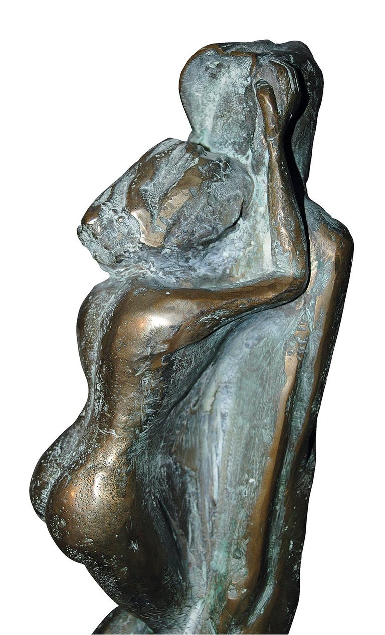 """This sculpture attracts us and responds to the deepest vibrations of our soul ! The artist called the sculpture """"The Unknown """"  As we cannot see who is beneath the big long coat, this sculpture transmit one's emotion in front of the great"""