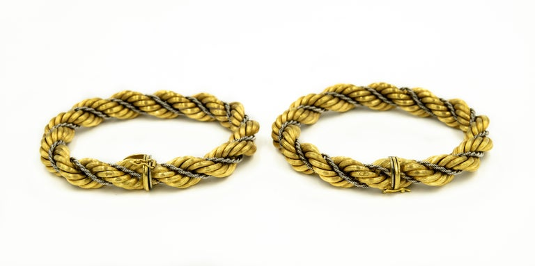 1970s Chic Italian set made by Vincenza jeweler Nicolis Cola.  The set includes a  18k pair of bracelets featuring a wider (10.75mm) twisted yellow gold rope chain intertwined with a thinner white gold rope chain.  They can be worn as bracelets or