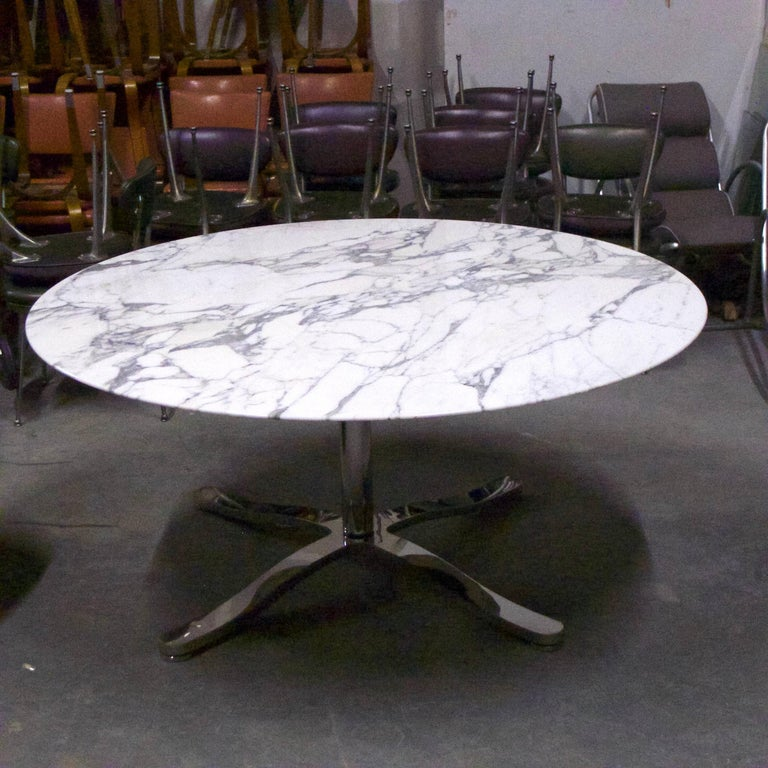 A very impressive and versatile Nicos Zographos Alpha table that could function as a dining, center, or conference table. The top is a beautiful single piece of 5 foot diameter Italian Calacatta marble stone with a beveled edge supported by a