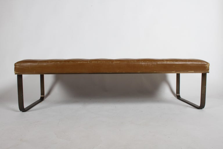 Leather tufted museum bench by Nicos Zographos with bronze base, circa 1965. Leather shows wear but no holes, bronze has patina. Label. Midcentury, Florence Knoll style.