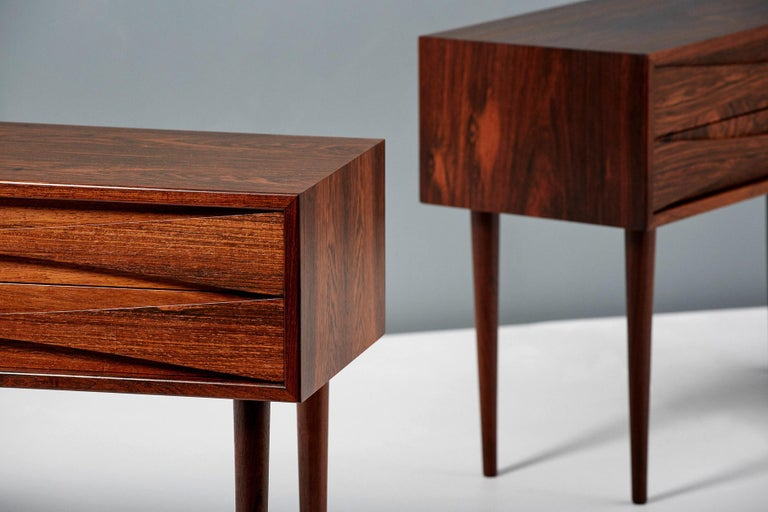 Pair of nightstand cabinets designed by Niels Clausen for NC Mobler in Odense, Denmark. Produced circa 1960 each with two drawers with scalloped pulls and solid tapered legs. Often misattributed to Arne Vodder.