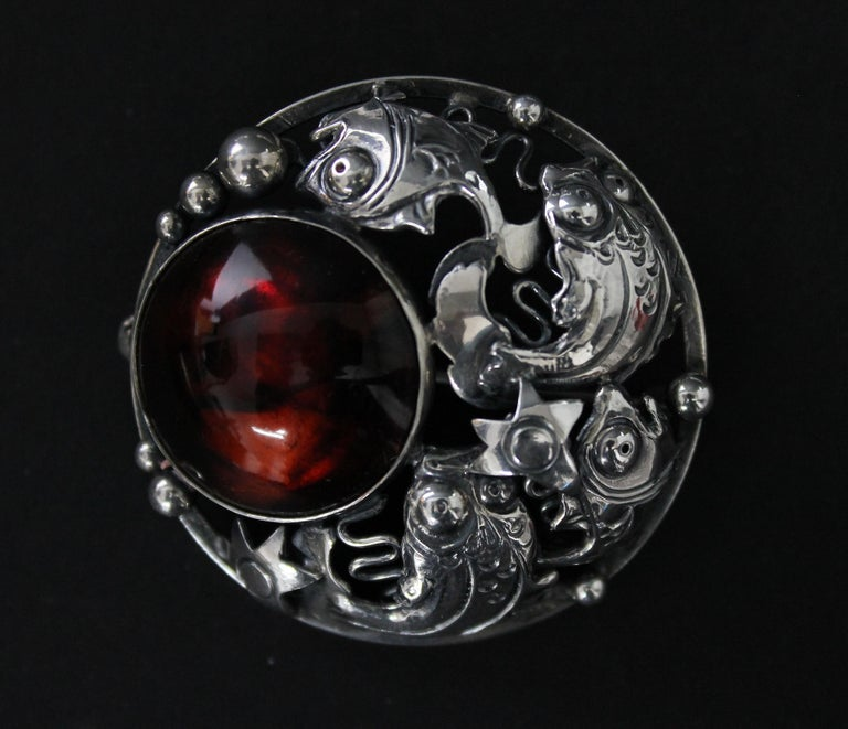Very nice brooch by Niels Erik From. You can see different kinds of very detailed fishes in a desperate hunt for food. Very good condition. Sterling silver and amber. Fully marked.  NIELS ERIK FROM  1908-1982 Danish jeweler and silversmith Niels