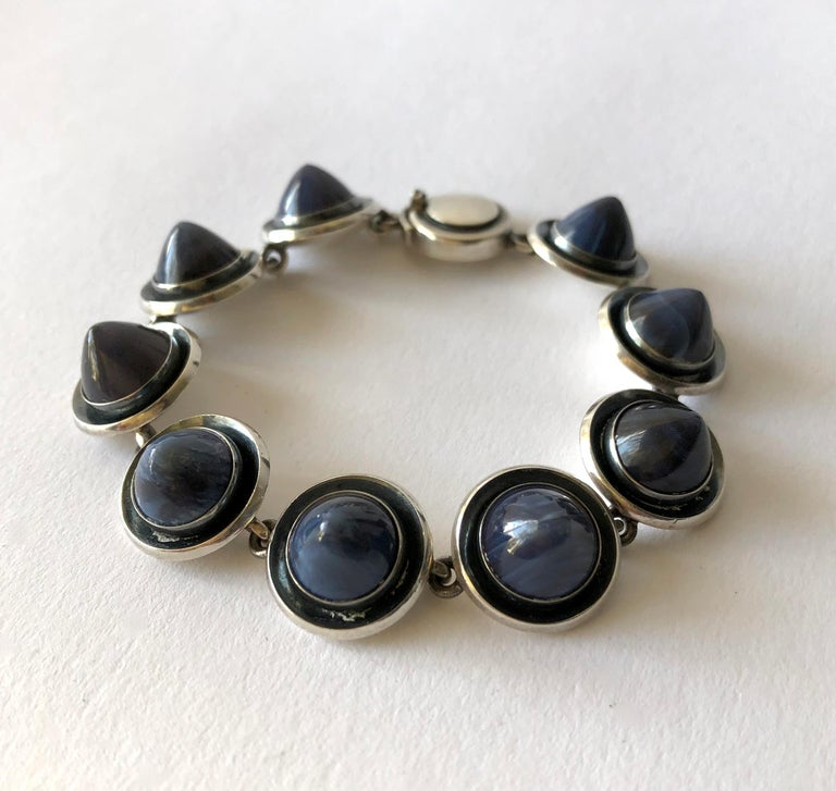 Danish modern sterling silver linked bracelet with conical shaped striped blue agate stones created by Niels Erik From, circa 1960's.  Bracelet measures 7 1/4