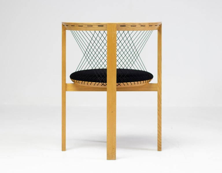 String armchair designed by Niels Jørgen Haugesen for Tranekaer in Denmark. Very smart and comfortable design. Because the 4 legs are configured with one leg in front, the person sitting on the chair can move his/her legs around freely. The
