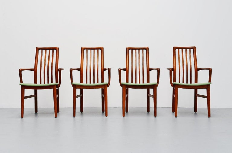 Very nice set of 4 armchairs designed by Niels Koefoed, manufactured by Hornslet Mobelfabrik, Denmark 1960. The chairs are made of solid teak wood and they are newly upholstered in mint green fabric. The arms have very nice dovetail connections at
