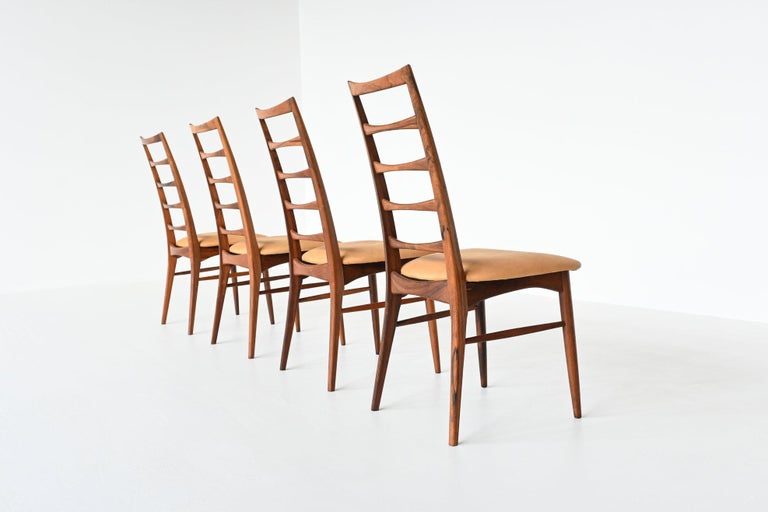 Beautiful shaped set of four dining chairs designed by Niels Koefoed and manufactured by Koefoeds Mobelfabrik A/S, Denmark 1961. These chairs are made of amazing grained solid rosewood and are reupholstered with an high quality natural camel colored