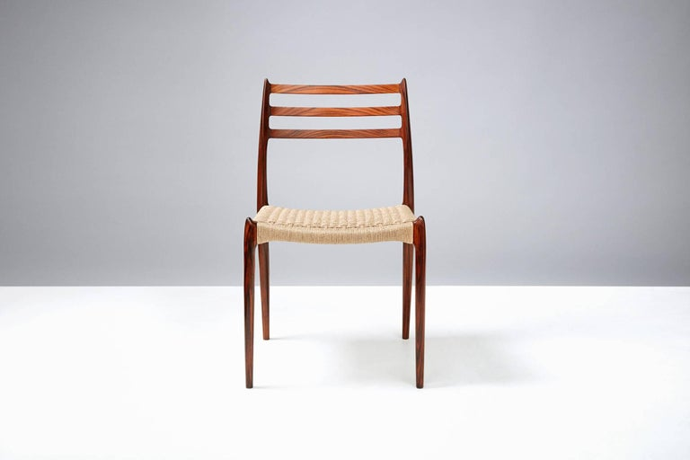 Set of eight rosewood dining chairs with woven Danish papercord seats. Designed by Niels O. Moller for J.L. Moller Mobelfabrik, Denmark, 1962.