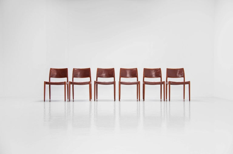 Very nice set of 6 teak dining chairs model 80, designed by Niels Moller and manufactured by J.L. Møller Mobelfabrik, Denmark 1966. The chairs have solid teak frames and original brown leather upholstery with a very nice patina from age and usage.