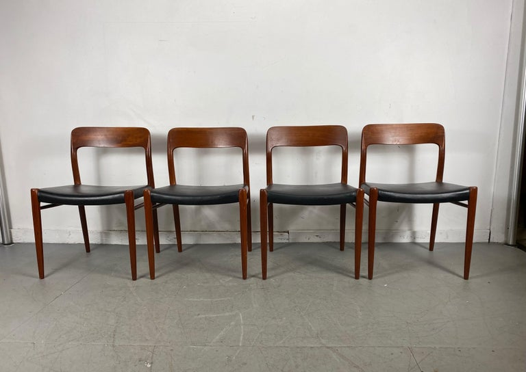 Niels Otto Möller Modell 75 for J.L. Möllers Mobelfabrik. Solid teak frame with black leather. Set of 4, Classic Danish modern set, retains original labels, nice early set, amazing original condition, extremely comfortable, hand delivery avail to