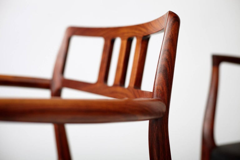 Leather Niels Moller Pair of Rosewood Model 64 Chairs For Sale