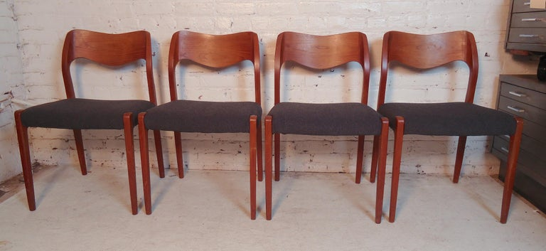 Classic Danish modern chairs designed by Niels O. Møller. With curving backs and tapered legs, all in teak wood. (Please confirm item location - NY or NJ - with dealer).