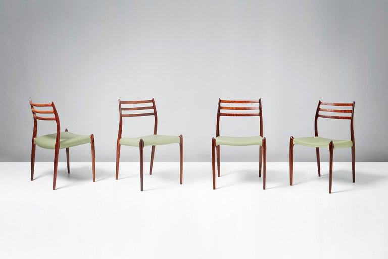 Niels O. Møller  Model 78 dining chairs, 1962.  Set of eight rosewood dining chairs designed by Niels O. Møller for J.L. Moller Mobelfabrik, Denmark, 1962. Seats reupholstered in premium pale green leather.  Larger sets and other upholstery