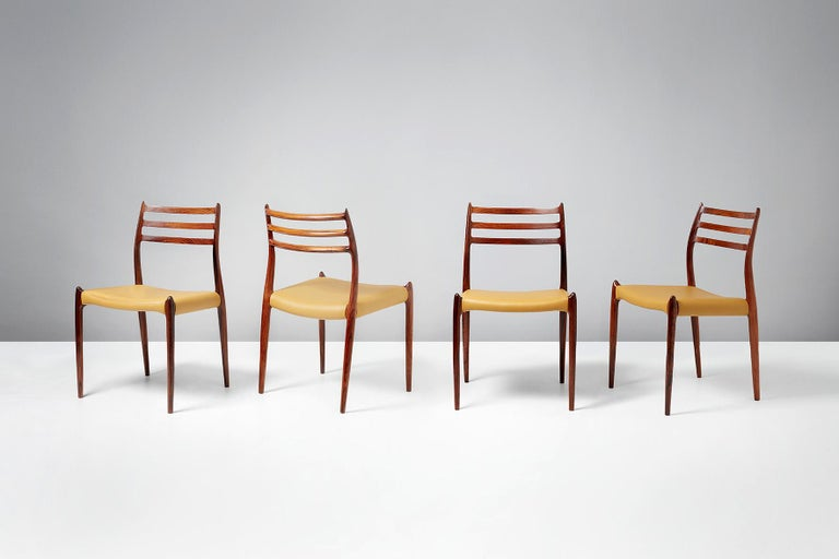 Niels O. Møller  Model 78 dining chairs, 1962.  Set of eight rosewood dining chairs designed by Niels O. Møller for J.L. Moller Mobelfabrik, Denmark, 1962. Seats reupholstered in premium golden yellow leather.  Larger sets and other upholstery