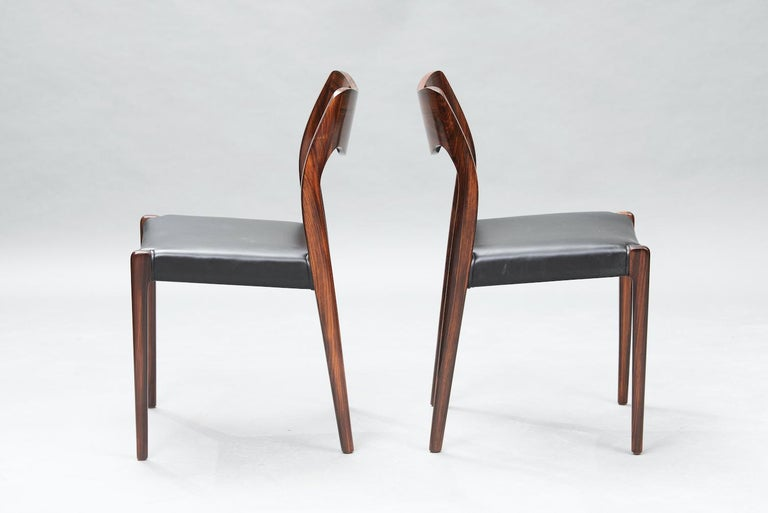 Set of six rosewood dining chairs by Niels O. Møller for J.L Møllers upholstered in black skai, model 71.