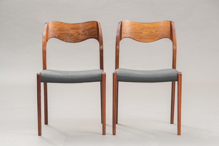 Set of ten rosewood dining chairs, reupholstered in grey fabric, model 71.