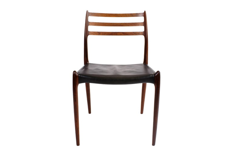 Niels O. Møller set of ten Brazilian rosewood dining chairs, horizontal bars in back. Seats with original black leather. Model 78. Designed 1962. Made by J. L. Møller.  The set is in excellent condition.  Price is for the set of ten chairs.