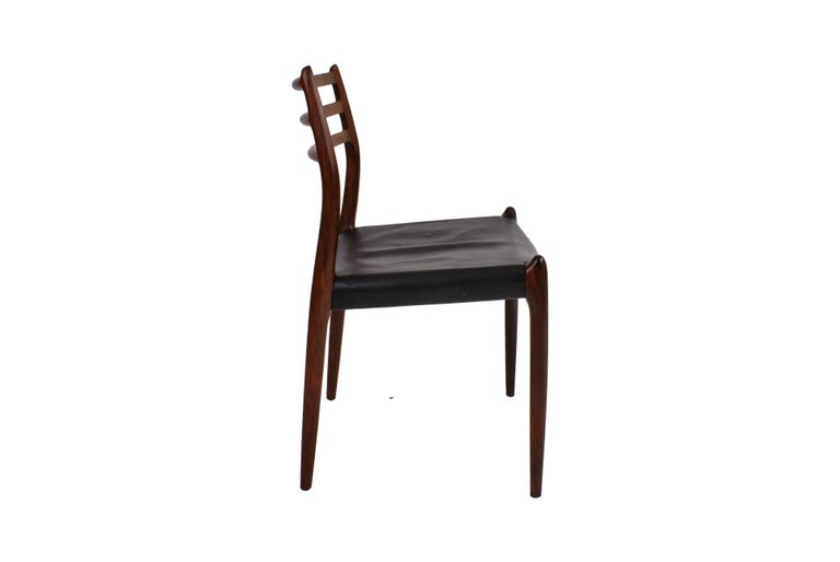 Scandinavian Modern Niels O. Møller Set of Ten Dining Chairs in Rosewood and Black Leather