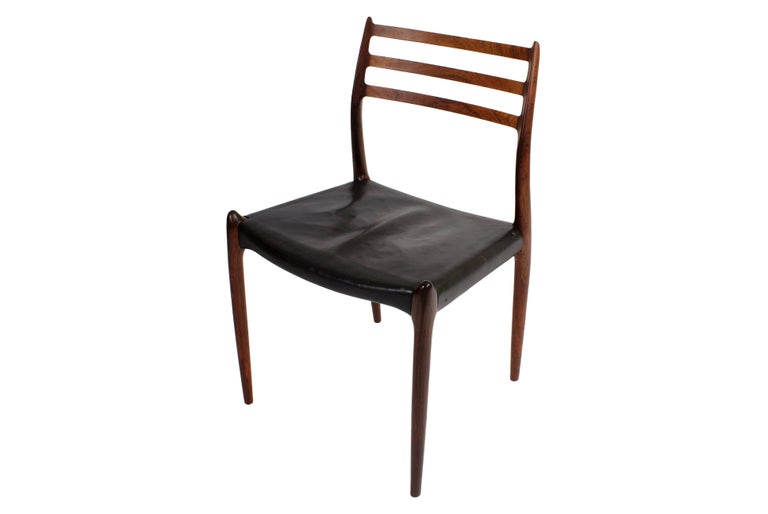 Danish Niels O. Møller Set of Ten Dining Chairs in Rosewood and Black Leather