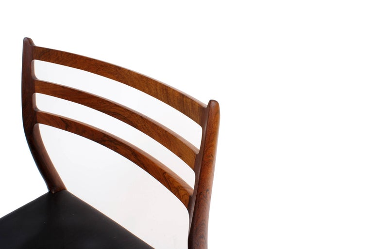 Niels O. Møller Set of Ten Dining Chairs in Rosewood and Black Leather 2