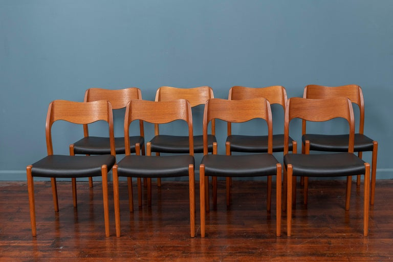 Niels O. Moller set of eight teak dining chairs, Model 71. In excellent original condition with teak frames and black leatherette seats, stamped.