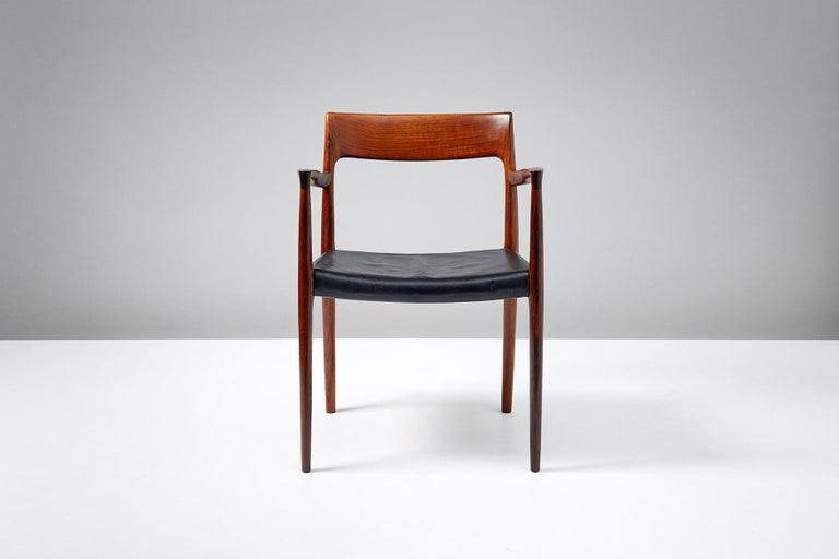 Niels O. Moller  Model 57 chair   Solid rosewood armchair produced by J.L. Moller Mobelfabrik, Denmark, 1959. Original, patinated black leather seat.  Measures: H 77 cm / D 50 cm / W 55 cm / SH 44 cm.