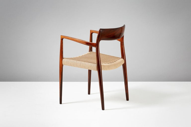 Niels O. Moller  Model 57 chair   Solid rosewood armchair produced by J.L. Moller Mobelfabrik, Denmark, 1959. Newly woven papercord seat.   Measures: H 77 cm / D 50 cm / W 55 cm / SH 44 cm.