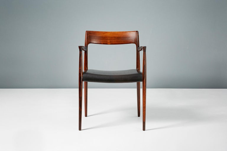 Niels O. Moller  Model 57 chair, 1959  Brazilian rosewood armchair produced by J.L. Moller Møbelfabrik, Denmark in 1959. Stunning Brazilian rosewood frame with exquisite grain. The seat has been reupholstered in aniline black leather.