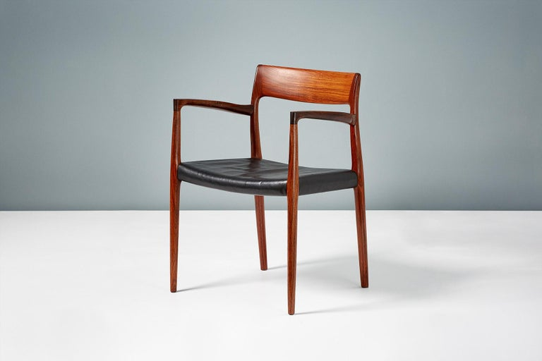 Niels O. Moller  Model 57 chair, 1959  Brazilian rosewood armchair produced by J.L. Moller Møbelfabrik, Denmark in 1959. Stunning rosewood frame with exquisite grain and original patinated black leather seat.   Measures: H 77 cm, D 50 cm, W 55