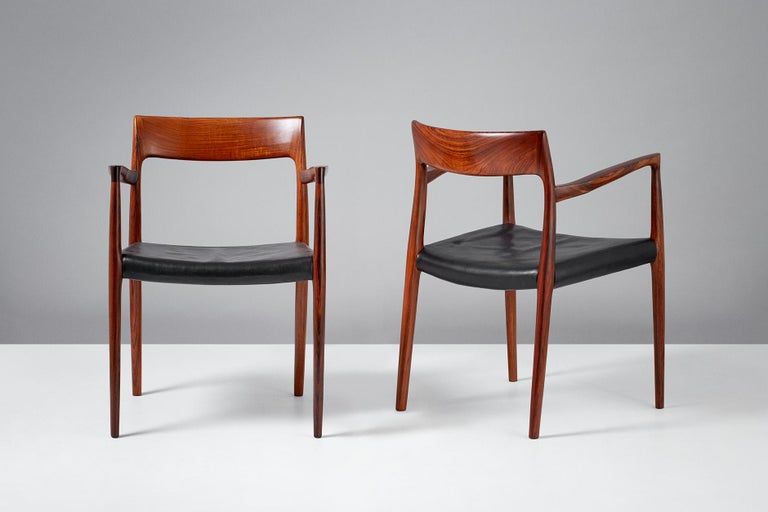 Niels O. Moller  Model 57 chairs, 1959.  Solid rosewood armchairs produced by J.L. Moller Mobelfabrik, Denmark, 1959. Original, patinated black leather seats.  Measures: H 77 cm / D 50 cm / W 55 cm / SH 44 cm.