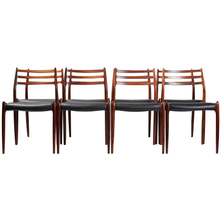 Niels O. Moller  Model 78 dining chairs, 1962  Set of eight rosewood dining chairs designed by Niels O. Moller for J.L. Moller Mobelfabrik, Denmark, 1962. Rare early productions with more slender frames. Seats reupholstered with new black