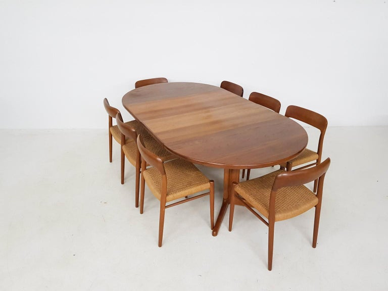 A set of 8 dining chairs designed by Niels Otto Møller. This specific model is number 75 and was made in Denmark in the 1950s. An excellent piece of Classic Danish modern furniture design. And a teak extendable dining table by Skovby Denmark.  The
