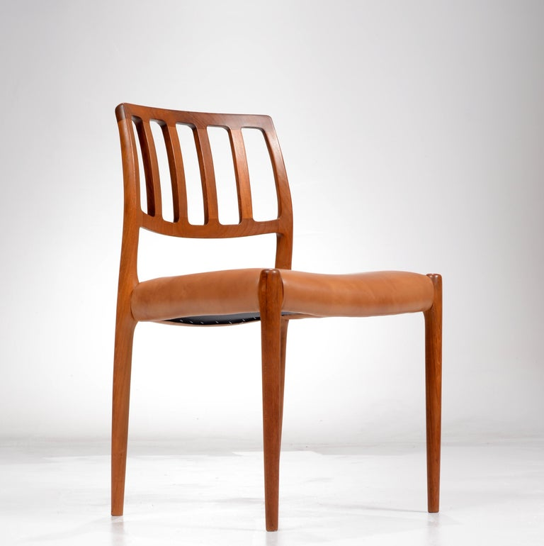 Set of six dining chairs designed by Niels O. Møller for J.L Møller Møbelfabrik in Denmark model 83, in teak and leather. Newly upholstered and restored, all chairs marked.