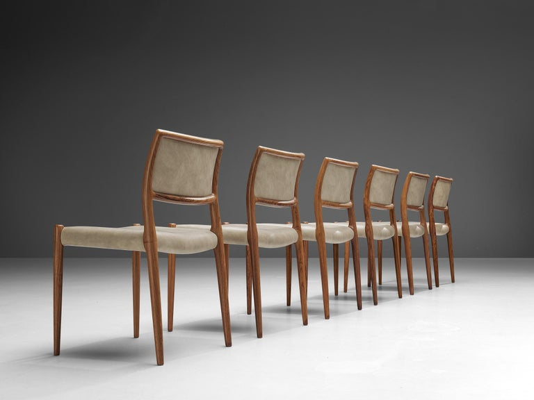 Niels OttoMøller for J.L. Mollersset of six dining chairs model 80, teak,leatherette, Denmark, 1960s  The model '80' byNiels OttoMøller in this case is upholstered in off-white leatherette that contrasts with the teak frame. The frame goes