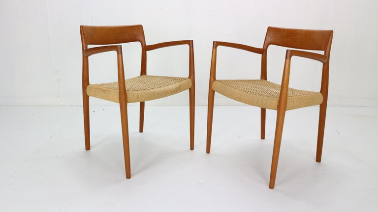 Scandinavian Modern period set of two chairs designed by Niels Otto Møller for J.L. Møllers Møbelfabrik manufacture, 1959, Denmark. Teak curved wooden frame and paper-cord seating. Model- 57, originally marked.