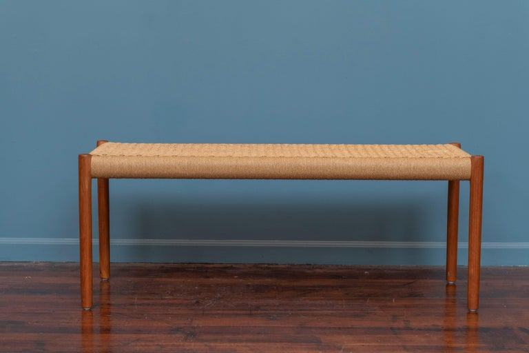 Niels Otto Moller teak and papercord bench, Model 63A. Vintage original danish teak bench in very good original condition with one almost unnoticeable small faded area. Ready to install.