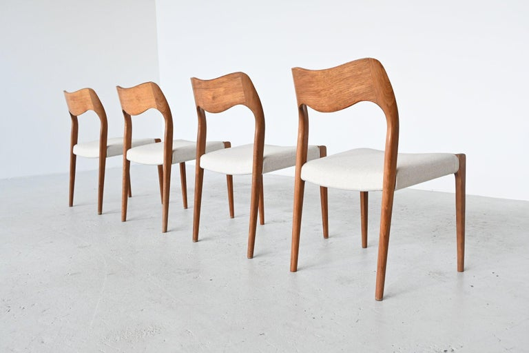 Beautiful set of 4 dining chairs model 71 designed by Niels Otto Moller and manufactured by J.L. Møller Møbelfabrik, Denmark, 1951. These chairs are made of solid teak wood and are newly upholstered with off-white high quality Richwool fabric. This