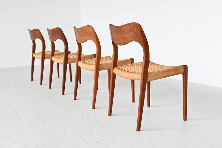 Very nice set of 4 dining chairs model 71 designed by Niels Otto Moller and manufactured by J.L. Møller Mobelfabrik, Denmark 1951. These beautiful shaped Scandinavian chairs are made of solid teak wood and they have original paper cord seats. They