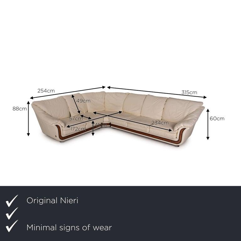 We present to you a Nieri Corniche leather sofa cream corner sofa couch.  SKU: #16879-c3     Product measurements in centimeters:     depth: 254  width: 254  height: 88  seat height: 41  rest height: 60  seat depth: 57  seat width: