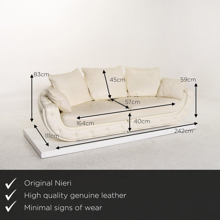We present to you a Nieri leather sofa cream four-seat couch.      Product measurements in centimeters:    Depth 111 Width 242 Height 83 Seat height 40 Rest height 59 Seat depth 57 Seat width 164 Back height 45.