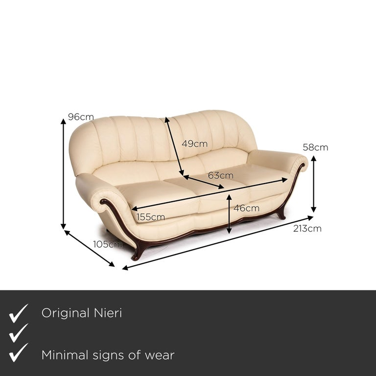 We present to you a Nieri leather wood sofa cream three-seater couch.    Product measurements in centimeters:    Depth: 105 Width: 213 Height: 96 Seat height: 46 Rest height: 58 Seat depth: 63 Seat width: 155 Back height: 49.