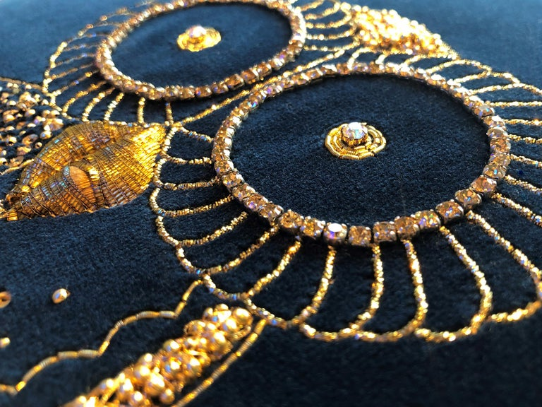 Luxury cushion in deep navy velvet material, featuring handmade embroidery by Lesage in crystals with antique gold thread and gold rope.   The cushions can be made completely bespoke and perhaps epitomize a movement now to bring back embroidery