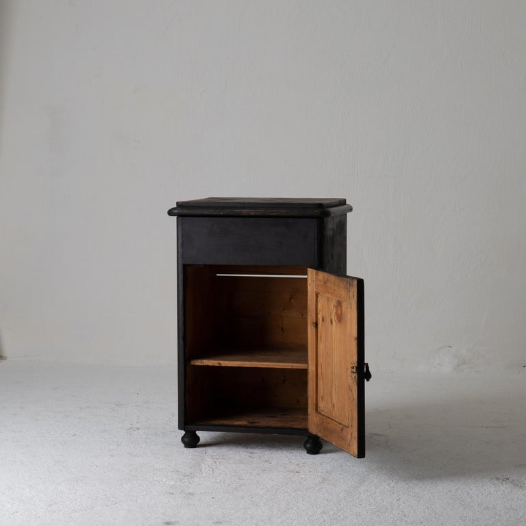 Nightstand Swedish black 19th century Sweden. A nightstand made during the 19th century in Sweden. Painted in our Laserow black. Interior with shelf. Contemporary hardware.