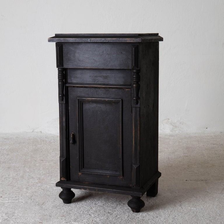 Nightstand Swedish black late, 19th century, Sweden. A nightstand made during the late 19th century in Sweden. Refinished in our matt black finish. Interior with one shelf. New hardware.