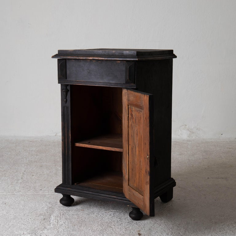 Nightstand Swedish black, late 19th century, Sweden. A nightstand made during the late 19th century in Sweden. Refinished in our matte black finish. Interior with one shelf. New hardware.