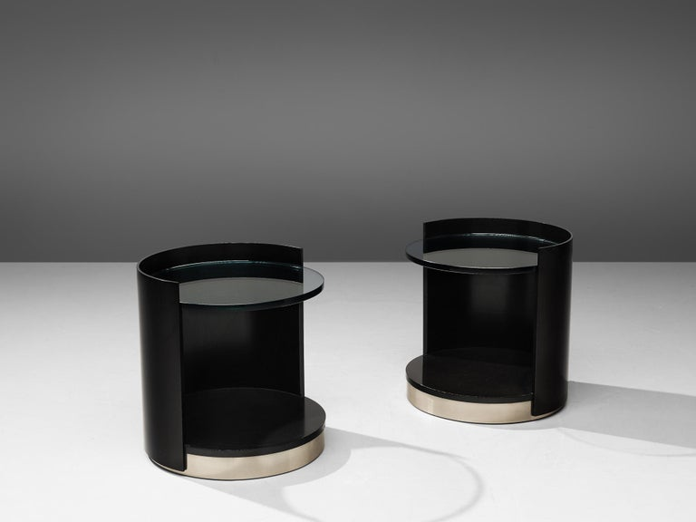 Gianni Moscatelli for Formanova, pair of side tables, wood, glass and metal, Italy, 1970s  Postmodern pair of nightstands by Gianni Moscatelli for Formanova. The tables have a cylindrical shape, featuring a black lacquered wood frame that's open