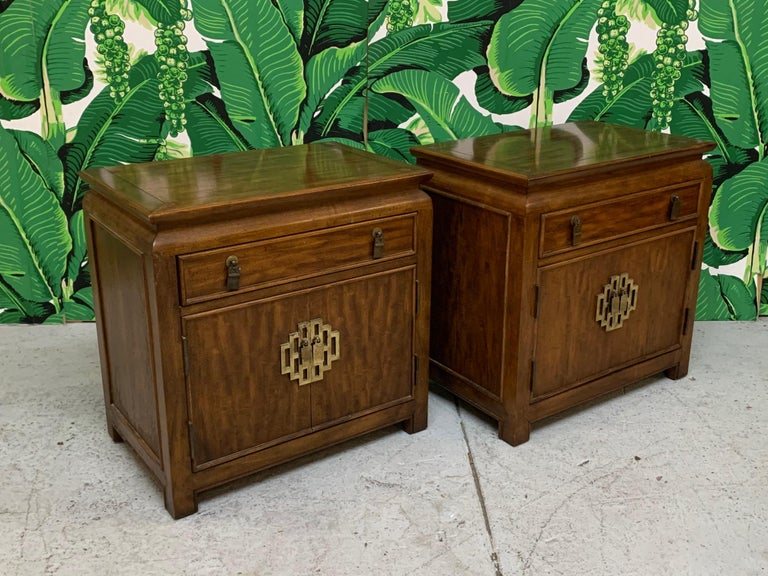 Pair of Asian chinoiserie nightstands by Raymond Sobota for the Century Furniture Chin Hua collection. Asian styling and heavy brass hardware. Very good condition with minor imperfections consistent with age, including marks on surface from pads